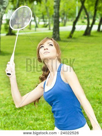 Beautiful Young Woman With Badminton Racket