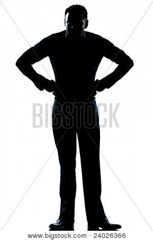 one caucasian man angry hands on hips full length silhouette in studio isolated white background