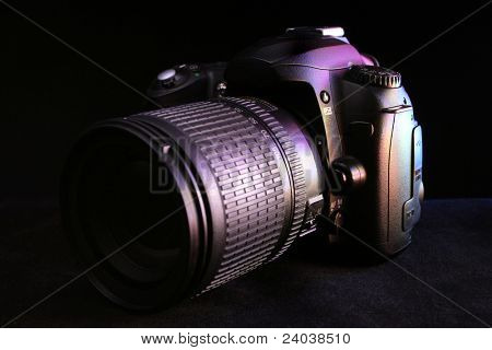 lens of the digital camera in colour light