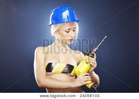 Blonde Model With Power Drill And Helmet