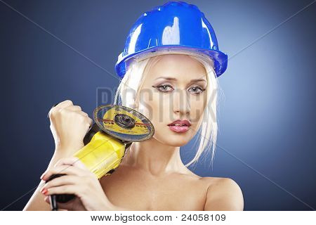 Portrait Of A  Blonde Model With Angle Grinder And Helmet
