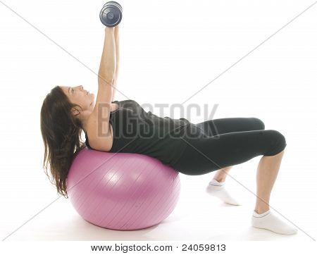Middle Age Senior Woman Fitness Exercising  Dumbbell Weights Core Training Ball