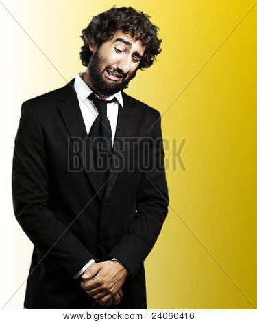 portrait of sad young business man over white and black background