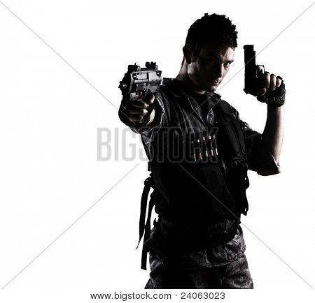 young soldier shooting with a pistol on a white background