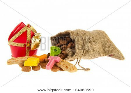Traditional Dutch Sinterklaas in jute bag with marzipan and pepernoten