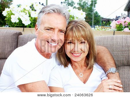 Senior smiling couple in love in garden.