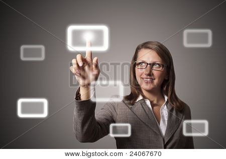 Young Business Woman Presses A Button Touch