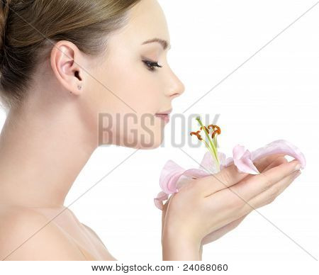Profile Of Girl Smelling Flower