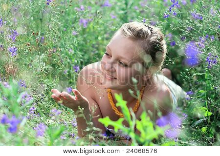 Young Girl Lying Among The Flowers