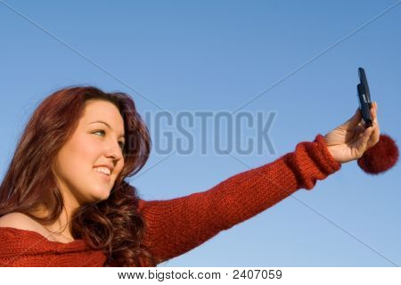 Young Woman With Cell Or Mobile Phone Camera