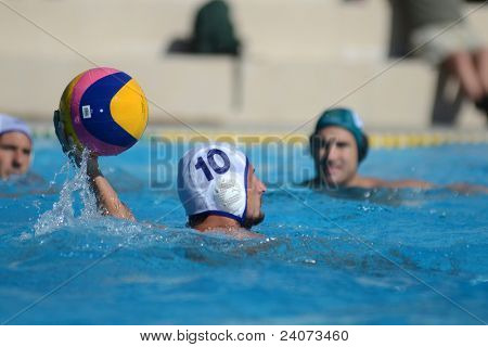 KAPOSVAR, HUNGARY - OCTOBER 1: Zoltan Balogh (white 10) in action at a Hungarian national championship water-polo game Kaposvar (white) vs. Honved (green) on October 1, 2011 in Kaposvar, Hungary
