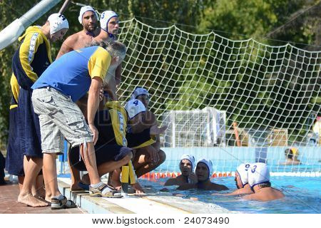 KAPOSVAR, HUNGARY - OCTOBER 1: Kaposvar players listening to trainer at a Hungarian national championship water-polo game Kaposvar (white) vs. Honved (green) on October 1, 2011 in Kaposvar, Hungary