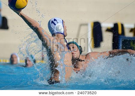 KAPOSVAR, HUNGARY - OCTOBER 1: Romeoo Kutasi (white 11) in action at a Hungarian national championship water-polo game Kaposvar (white) vs. Honved (green) on October 1, 2011 in Kaposvar, Hungary