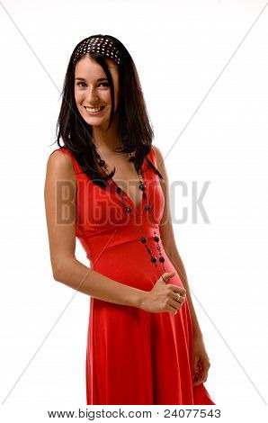 Young Brunette Woman In A Red Dress