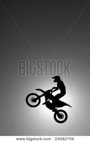 Motocross biker flying high