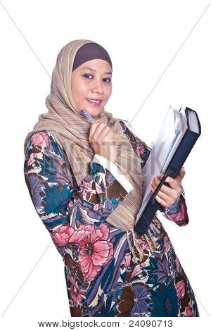 Beautiful liberated Muslim woman with books.