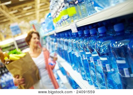 Image of many plastic bottles with water in a shop