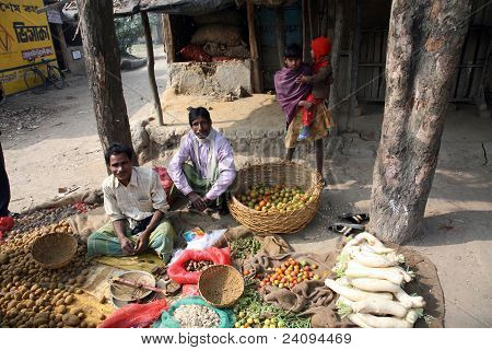 Tribal Villagers Bargain For Vegetables