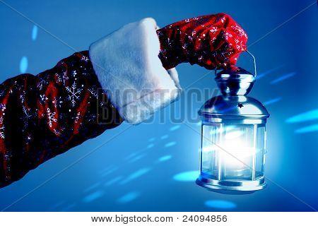 Santa Holding A Lamp