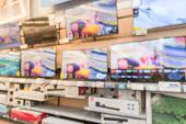 Abstract Blurred Electronic Department Store With Row Of Tvs In Usa poster