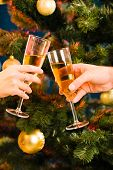 image of christmas meal  - The glasses of champagne making a clink on the background of christmas - JPG