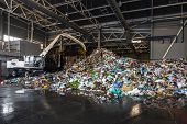 Excavator Sorts Plastic Garbage At Waste Processing Plant. Separate Garbage Collection. Recycling An poster