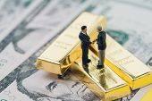 Deal Or Negotiation In Investment, Gold, Wealth Management Concept, Miniature People Rich Businessma poster