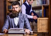 Writers Routine Concept. Writer Working On New Book With Bookshelves On Background. Man With Beard A poster