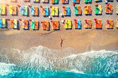 Aerial View Of Lying Woman On The Beach With Colorful Chaise-lounges poster