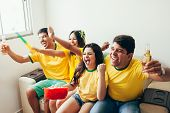 Group Of Friends Watching Soccer Game On Television, Celebrating Goal And Screaming poster