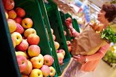 stock photo of grocery-shopping  - Image of fresh apples in supermarket - JPG