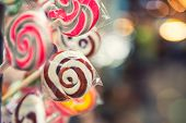 Lollipop Background. Colorful Lolly Pops Wrapped In Cellophane With Blurred Bokeh Background. Select poster