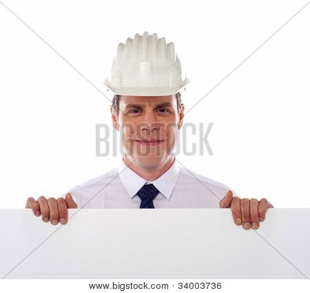 An Architect Holding Blank White Placard