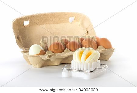 Egg Slicer With A Box Of Eggs
