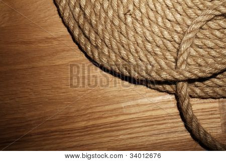 Old rope over wooden background