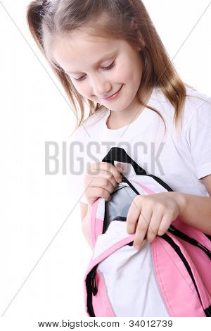 Cute girl with schoolbag over white background