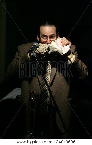 MADISON, NJ - JUNE 16: Steve Turre blows into two conch seashells as he performs with his Quartet at Shanghai Jazz on June 16, 2012 in Madison, NJ.