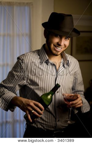Young Man In A Fedora With Red Wine