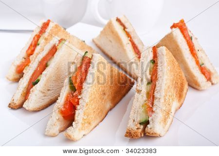 six salmon club  sandwiches