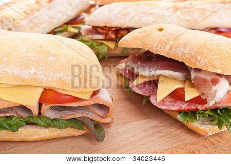 group of stuffed sub sandwiches on a table
