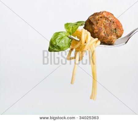 spaghetti with meatball on a fork