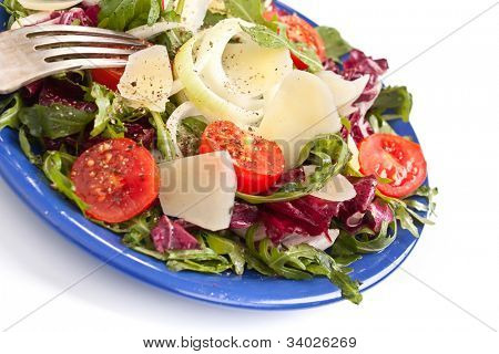 healthy salad mix with cheese on a plate close up