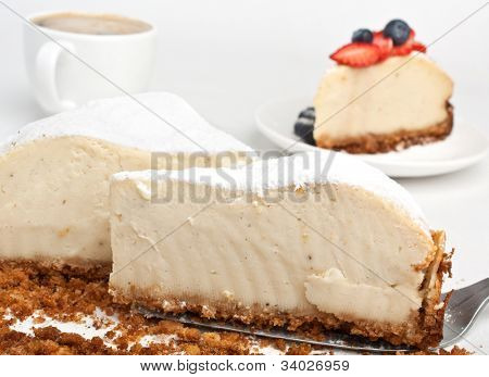 piece of tasty vanilla cheesecake with coffee