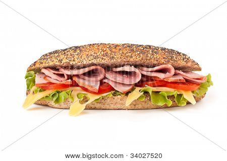 long whole wheat baguette sandwich with lettuce, tomatoes, ham, turkey breast and cheese