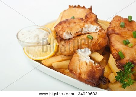 Fish and chips on a plate on white background