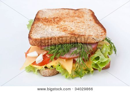 meat, lettuce , cheese and egg salad  sandwich on toasted bread