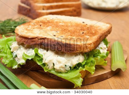 egg salad sandwich on brown toasted bread and ingredients