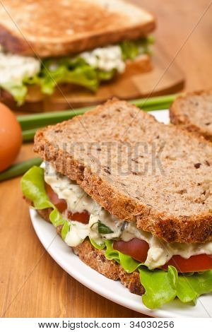 egg salad sandwiches on brown and white toasted bread