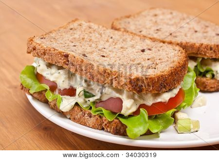 egg salad sandwiches on brown toasted bread