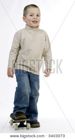 Boy Riding A Skate Board